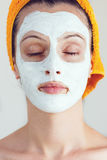 Woman having a white smoothing face mask Stock Photo