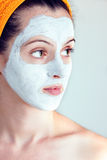 Woman having a white smoothing face mask Royalty Free Stock Photos