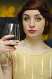 Woman having wine. Portrait of a young woman having a glass of wine Stock Photo