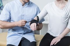 Woman having a wrist stabilizer Stock Images
