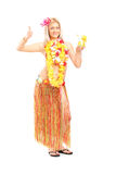 Woman in hawaiian costume giving thumb up Stock Photography