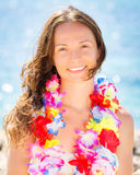 Woman with hawaiian flowers garland Stock Photo