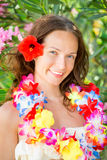Woman in hawaiian flowers garland Stock Images