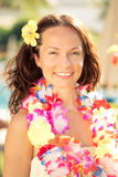 Woman in hawaiian flowers garland. Young smiling woman in hawaiian flowers garland on the beach. Summer vacations concept royalty free stock image