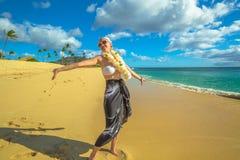 Woman with Hawaiian Lei. Woman with flower neck garland. Freedom bikini woman in Makua Beach, Waianae coast, Hawaii. Makua Valley, Oahu island royalty free stock image