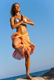 Woman with Hawaiin lei meditating. Royalty Free Stock Photo