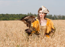 Woman with hawk on hand Royalty Free Stock Image
