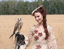 Woman with hawk on hand Stock Photo