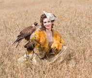 Woman with hawk on hand Royalty Free Stock Photos