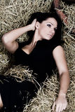 Woman on hay Stock Photos