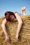 Woman on hay Royalty Free Stock Image