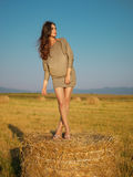 Woman on hay bale Stock Photography