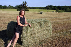 Woman on a hay bale Royalty Free Stock Photo