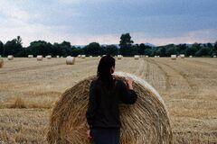 Woman with hay bale
