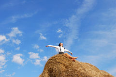 Woman on hay bale in summer field Royalty Free Stock Photos