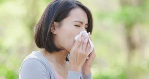Woman with hay fever. In the forest Stock Photos
