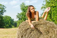 Woman at the haystack Royalty Free Stock Photos