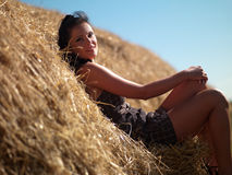 Woman on a haystack Stock Photo