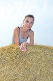 The woman on a haystack. Stock Images