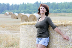 Woman on the haystack Royalty Free Stock Photography