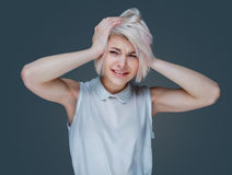 Woman with head-ache Royalty Free Stock Image