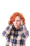 Woman with head ache. Holding her head. Isolated over white background Stock Images