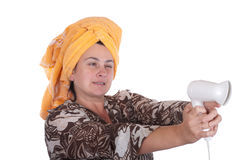 Woman and head aims from the hair dryer. On a white background Royalty Free Stock Image