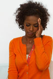 Woman with head and back pain. African American woman with head and back pain Royalty Free Stock Image