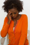 Woman with head and back pain. African American woman with head and back pain Stock Photography