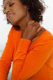 Woman with head and back pain. African American woman with head and back pain Royalty Free Stock Photos