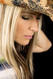 Woman head close with colored cowboy hat eyes closed Royalty Free Stock Photography