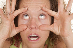 Woman head close hands make eyes wide Royalty Free Stock Image