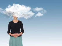 Woman with head in the clouds, daydreaming or creativity concept Stock Image