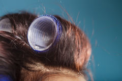 Woman head with hair curlers rollers Royalty Free Stock Photo