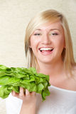 Woman with a head of lettuce Stock Image