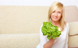Woman with a head of lettuce Stock Photography
