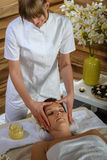 Woman head massage at luxury spa centre Stock Photography