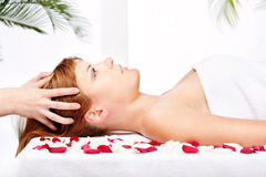 Woman on head massage treatment in salon Royalty Free Stock Photo