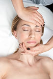 Woman on head massage in wellness Royalty Free Stock Photos