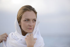 Woman with head scarf on the beach Royalty Free Stock Photos