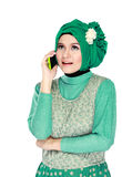 Woman with head scarf calling by phone Royalty Free Stock Photography