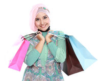 Woman in head scraf holding a few shopping bags Stock Images