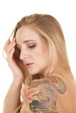 Woman head tattoo on shoulder serious Stock Images
