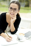 Woman with head tilted up smiling Stock Photo