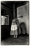 Woman without a head wearing folk costume. Mixed media artwork. Mixed media artwork. A woman without a head, wearing folk costume, standing in the somber room Stock Photos