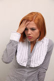 Woman with  headache. Portrait of a woman with severe headache Stock Image