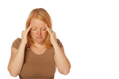 Woman with a headache. Woman on an isolated background expressing she has a headache Stock Image