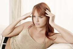 Woman with  a headache. Red-haired young girl, woman with  a headache Royalty Free Stock Images