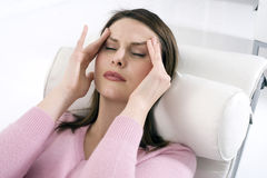 Woman with headache. Woman with closed eyes laying with headache Royalty Free Stock Photo