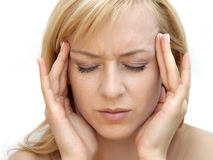 Woman with headache. Beautiful young girl suffering from a headache Stock Photo